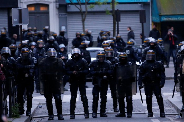 French CRS riot police face off with demonstrators after the announcement of results in the election of Emmanuel Macron as French President, in Paris